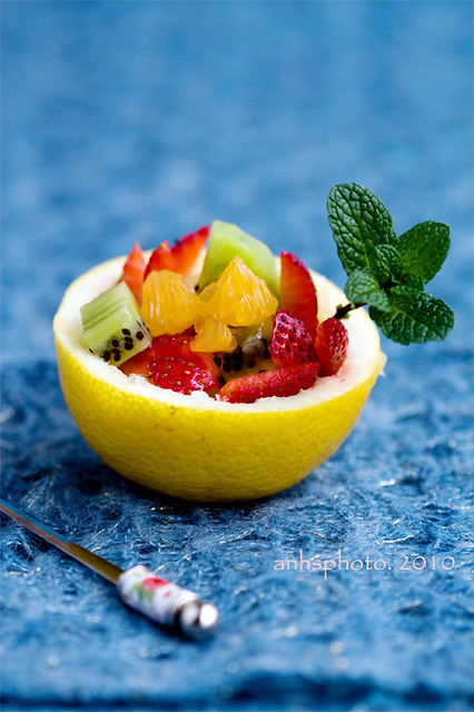 Fruit salad in lemon bowl