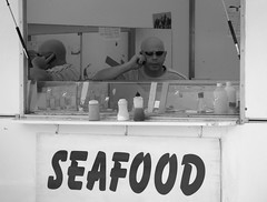 Seafood Man (Alexander Jones - Documentary Photography) Tags: street wales photography moments candid south documentary olympus decisive porthcawl e500