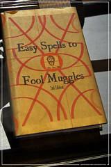 The Establishing Shot: HARRY POTTER EXHIBITION - LONDON FILM MUSEUM: HOGWARTS BOOK EASY SPELLS TO FOOL MUGGLES 2ND EDITION FROM THE PRISONER OF AZKABAN (Craig Grobler) Tags: uk london film lego wand harrypotter quidditch hogwarts witchcraft prisonerofazkaban props slytherin hagrid spells muggles gobletoffire howler hermionegranger cadogan hufflepuff gryffindor wizardry ashwood ravenclaw lfm orderofthephoenix triwizard filmmemorabilia sorcerersstone darkarts ronweasly chamberofsecrets ckc1ne sircadogan craiggrobler hogwartsemblem hogwartsschoolofwitchcraftandwizardry filmcostume terryenglish harrypotterexhibition hogwartsuniform headlessknight theestablishingshot wwwtheestablishingshotcom londonfilmmuseum thelondonfilmmuseum atckc1ne hogwartsschoolofwitchcraftandwizardrystudentbooks thestandardbookofspellsgrade5 thestandardbookofspells theessentialdefenceagainstthedarkarts darkartsdefencebasicsforbeginners thedarkforcesaguidetoselfprotection easyspellstofoolmuggles2ndedition quidditchgreenscreen ronweaslyoutfit nimbusquidditchbroom harrypottersgryffindorquidditchoutfit quidditchoutfit dragontask triwizardtournamenttrophy hermionegrangershogwartsuniform howlerletter ronweasleyswand unicornhaircore headlessknightarmour sircadogansarmour theestshot attheestshot