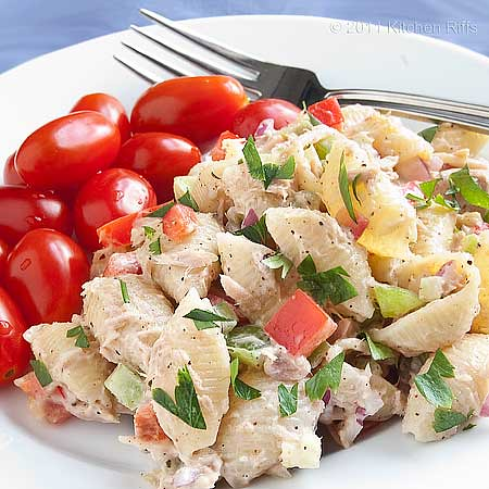 Tuna Pasta Salad on plate with grape tomatoes