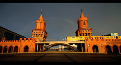 Rainbow over the Oberbaumbrucke - Berlin (kryyslee) Tags: travel bridge blue light en orange sun color berlin colors yellow canon kreuzberg germany photography eos photo rainbow foto metro photos couleurs over arc picture sigma ciel ubahn pont christophe 8mm backpacker allemagne couleur arcenciel brucke oberbaum oberbaumbrucke kreutzberg 50d 816mm kryyslee christophepaquignon paquignon