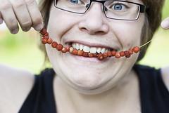 Looney wild strawberries (netzanette) Tags: portrait face closeup mouth happy 50mm nikon sweden bokeh teeth naturallight wildstrawberries wildstrawberry d80 nikond80