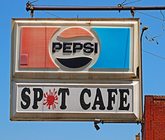 SPIT or SPOT (FotoEdge) Tags: city blue red usa white signs electric lights town cafe bricks rusty stjoseph spit bluesky spot plastic sidewalk missouri wires handpainted hanging wired pepsi crusty saintjoseph molded kingshill cafesign fotoedge southstjoe