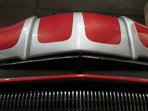 Abstract Red and Silver Grill Design