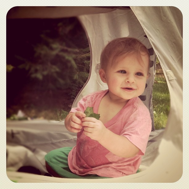 Baby girl in a tent.