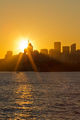 Setting Sun Over North Sydney (Craig Jewell Photography) Tags: city sun reflection skyline skyscraper evening cityscape bright harbour iso400 sydney australia northsydney bradleyshead f32 1125sec ef135mmf2lusm canoneos1dmarkiv cpjsm craigjewellphotography