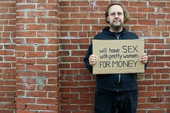Crigger out on da' street, tryin' ta make dat money! (Craig Walkowicz) Tags: man male sign homeless prostitute cardboard brickwall selling gigolo ccw cardboardsign criggerthetrigger
