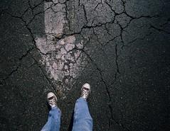 and the Earth, moved, under my feet... (Mr. Greenjeans) Tags: urban feet parkinglot converse arrow cracks asphalt chucks allstars 10mm canonefs1022mmf3545usm mrgreenjeans gaylon gaylonkeeling