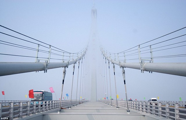 That is a £1bn bridge too far World's longest sea bridge opens to traffic in China... but it will only hold the title for five years  8