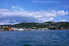 Flekkefjord from the fjord (BangsUndeveloped) Tags: blue vacation sky norway clouds boat norge ship norwegian fjord flekkefjord byfjorden canonxsi