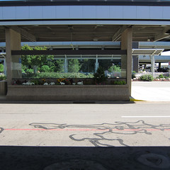 Brutal Flowers in June (nateOne) Tags: airport pickup flowerbed slc schnivic curb brutalism 6mm dropoff iso80 6225mm 11000secatf20 canonpowershots95 focusdistance6440m