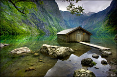 Obersee (katepedley) Tags: park lake mountains reflection rain rock forest canon germany deutschland bavaria berchtesgaden europe cloudy eu hut national 5d boathouse 1740mm obersee polariser konigssee