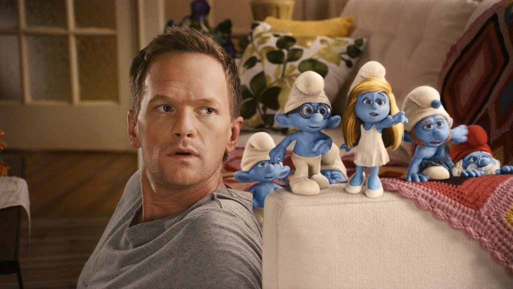 "Neil Patrick Harris as ""Patrick"" with Clumsy, Briany, Smurfette, Gutsy and Papa Smurf"