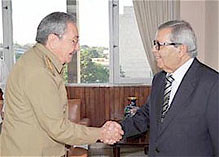 Cuban President Raul Castro greets Libyan Minister of Finance and Planning Abdulahafid M. Zlitni in Havana. President Castro reiterated the call for a negotiated settlement to the civil war inside the North African state. by Pan-African News Wire File Photos