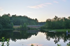 tranquil scene (chumlee10) Tags: county bridge sunset lake man water girl wisconsin fishing iron niceshot sony mercer wi a300 lakeofthefalls