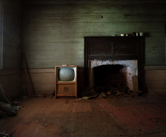Anyone seen the remote? (History Rambler) Tags: wood old longexposure light shadow house abandoned home rural vintage dark tv fireplace decay south debris northcarolina historic southern plantation hearth georgian walls antebellum mantel windowlight franklincounty oldrugs findtheclotheshanger pewsweremovedinthemakingofthisphoto ifinallyfoundtheremote