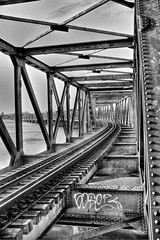 Bridge of Hope (J Howe) Tags: bridge newzealand blackandwhite bw water hope graffiti fuji personal steel railway handheld traintrack soe tauranga bayofplenty aperturepriority x100 bridgeofhope jasonhowe mygearandme matapihibridge fujix100 janrzm aperturepriorityconz matapihirailbridge aperturtepriority wwwaperturepriorityconz httpwwwaperturepriorityconz