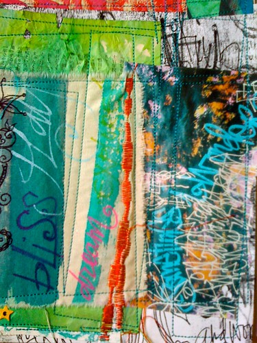 a mash up of collage, painted fabric, dictionary pages and inkjet prints stitched