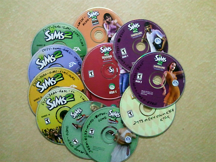 The Sims 2 discs, expansions and stuff packs