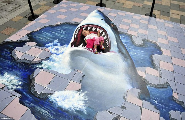 Art attack Toddler snapped in great white's 3D teeth