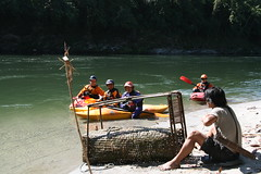 Kayakers checking out a fish trap on the Kameng river Adventure rafting and Kayaking trip