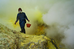 sulfur miner on ijen crater (yunaidi joepoet) Tags: kawah ijen stone mirror gunung perjalanan foto photo crater sulfur sulphure biggest acid lake eastjava mount night malam asap mine miner tambang belerang banyuwangi bondowoso indonesia east volcano big surabaya minner landscape worker labour carries sunrise hill morning misty fog keranjang silhoute siluet kekayaan alam photostock reflection