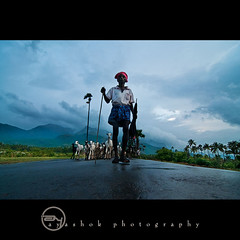sHEphard (ayashok photography) Tags: people india man rain clouds nikon rainyday sheep cloudy indian dude tamilnadu shephard thenkasi ayashok nikond300 tokina1116mm ruraindia aya8632