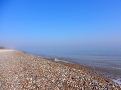 Dunwich Beach, Suffolk (DaveJC90) Tags: blue light sky sun sunlight hot beach wet rock stone bay suffolk movement walk wave sunny move sharp clear bubble dunwich sharpness blinkagain