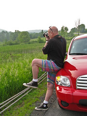 """One of the risks of appearing in public is the likelihood of being photographed."" (the billyllama) Tags: chevrolet fence roadtrip cable converse todd chucks allstars hhr catskillmountains redhotchilipepper onwheels twcollins vlaipond"