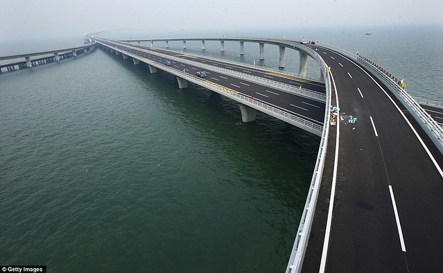 That is a £1bn bridge too far World's longest sea bridge opens to traffic in China... but it will only hold the title for five years  2