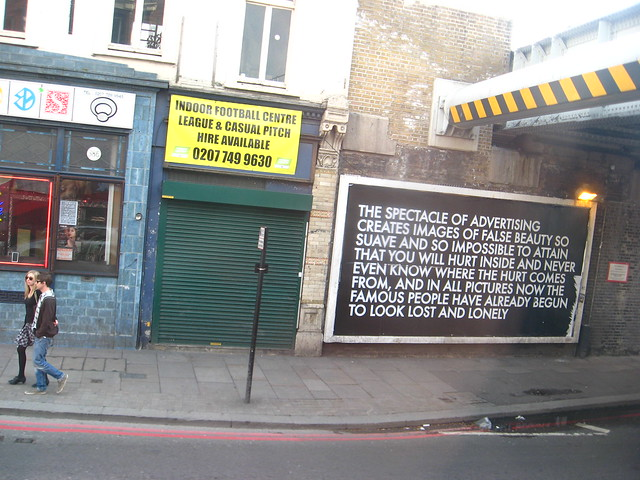 The Spectacle of Advertising Creates Images of False Beauty - Old Street, London, 2010