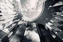 Curved (Philipp Klinger Photography) Tags: light shadow sky bw white house distortion black paris france reflection building tower glass architecture clouds skyscraper reflections la blackwhite nikon frankreich europa europe distorted ladefense and curve curved philipp iledefrance defense entrace puteaux klinger d700 dcdead
