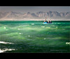 Kalkbaai Fishingboat... (Chantal Steyn) Tags: ocean africa blue light sea sunlight mountain seascape mountains green water landscape southafrica boat fishing nikon aqua waves vessel capetown coastal fishingboat illuminate kalkbay westerncape d300 fishingvessel turqois singleshot oceanscape kalkbaai nohdr 1685mm
