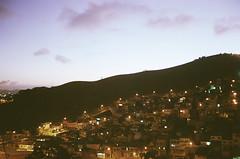 mauá city (Diet Munhoz) Tags: blue houses light brazil sky mountain film azul brasil clouds analog photography evening analógica hill céu nuvens suburb luzes diet paulo fotografia sao casas morro montanha anoitecer mauá película subúrbio munhoz