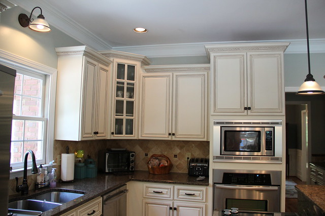 glazed cabinets with silver sage blue paint