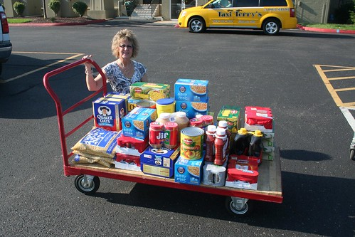 USDA Rural Development State Director for Missouri Anita J. (Janie) Dunning with food donation to Feds Feed Families.