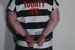 Pennington_5066 - Look says 'prisoner' (skinmate) Tags: uniform inmate restraints handcuff maximumsecurity hss9