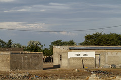Top Life (cowyeow) Tags: poverty life africa street old bar weird town funny village sad top african empty bricks wrong prostitution alcohol badsign irony booze rough ironic decrepit namibia funnysign dilapidated brothel rundown namibian uglybuilding funnyname ruacanafalls ruacana crapsign funnyafrica