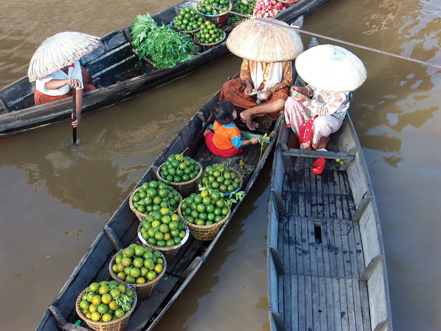 Bartering food on boats in Indonesia
