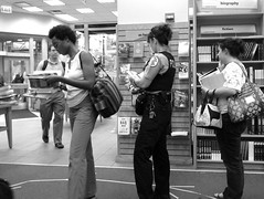 Waiting to buy a bargain at Borders (yooperann) Tags: street people woman chicago reading waiting uniform state loop sale police line queue department officer borders shoppers goingoutofbusiness chicagoist