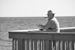 A rod and a cigar (Juliancolton2) Tags: ocean bw pier fishing fisherman florida cigar deerfieldbeach angler angling