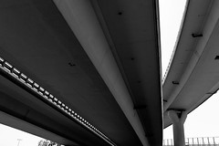 roads (Daniel Kulinski) Tags: road street city urban blackandwhite bw white abstract black monochrome car tarmac speed way concrete highway europe image 10 transport under central shapes evil samsung poland move minimal line communication ten warsaw civic simply asphalt minimalistic beton fas nx urbanshapes noclolor samsungimaging nx10 samsungnx10 gettypoland1