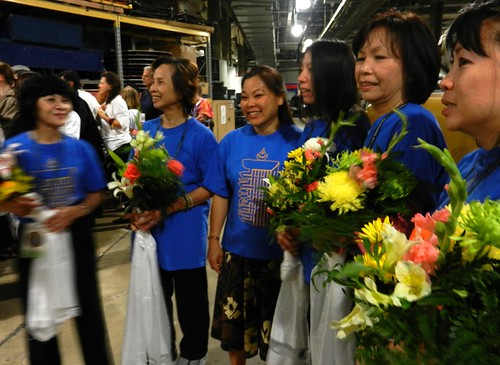 Backstage ladies in the blue shirts with the Kalachakra symbol, hold flowers and khatas, Kalachakra for World Peace, preparing the mandala offerings to His Holiness the 14th Dalai Lama, Washington D.C., USA by Wonderlane