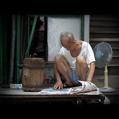 Informed (Michael Steverson) Tags: china street old urban man men canon reading newspaper asia central chinese squat hong kong chinadigitaltimes 5d wan ef2470mmf28lusm markii sheung