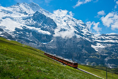 To the Jungfrau (Thierry Hennet) Tags: blue red summer cloud white snow flower green nature grass zeiss train landscape switzerland suisse sony sunny glacier snowcapped jungfraujoch jungfrau berneroberland berneseoberland mountainrange kleinescheidegg traveldestinations a900 cz1635mmf28