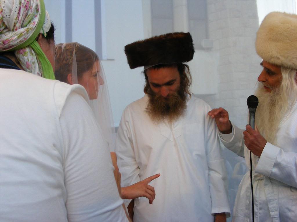 Rabbi Froman guides his son under the 'hupah', wedding canopy