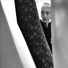 No need to look back, the train moves relentlessly forward (Paul..Andrews) Tags: travel portrait woman face train candid final age worry anxiety iphone spnp week52 streetphotographynowproject instruction52