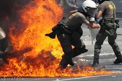 (spirofoto) Tags: people man square greek fire photo fight riot foto photographer metro photos internet journal protest photojournalism police greece international flame staff revolution imf griechenland riots flaming proteste journalism reportage athen fund monetary syntagma freelancer fotoreporter aufstand griegos occupy sintagma spirofoto          indignados            antimemorandum