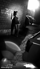 Across Town (Andreas Springer) Tags: street woman girl fashion pose blackwhite model nikon shadows outdoor jenny lensflare blitz kontrast vignette speedlight schatten strobe cls gegenlicht abendsonne schwarzweis strase creativelightingsystem strobist lichtreflexe fullbodyshot blendenflecke kontrastreich ganzkrper sb900