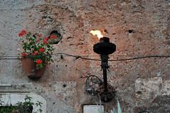 Oil Lamp (caribb) Tags: city flowers urban italy rome roma italia flame centrum italie stad oillamp stedelijke piazzademercanti tabernademercanti latavernademercanti